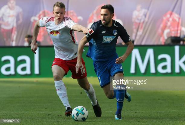 Lukas Klostermann of Leipzig battles for the ball with Lukas Rupp of Hoffenheim during the Bundesliga match between RB Leipzig and TSG 1899...