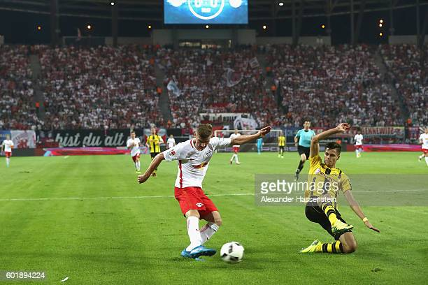 Lukas Klostermann of Leipzig battles for the ball with Sokratis of Dortmund during the Bundesliga match between RB Leipzig and Borussia Dortmund at...