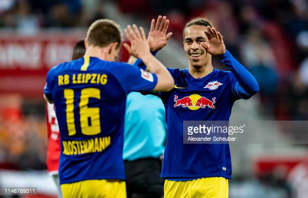 Lukas Klostermann of Leipzig celebrates the second goal for his team with Yussuf Poulsen of Leipzig during the Bundesliga match between 1. FSV Mainz...