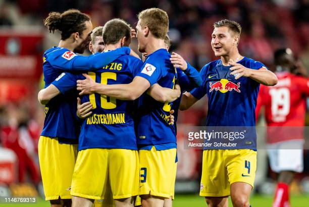 Lukas Klostermann of Leipzig celebrates the second goal for his team with Yussuf Poulsen of Leipzig, Willi Orban of Leipzig and Marcel Halstenberg of...
