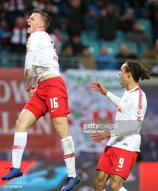 Lukas Klostermann of Leipzig celebrates with teammate Yussuf Poulsen after scoring his team's first goal during the Bundesliga match between RB...