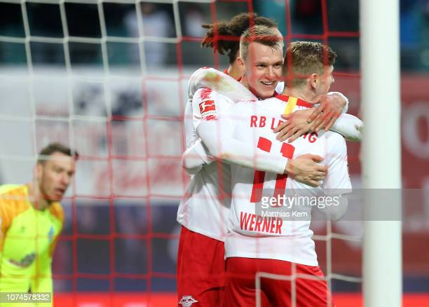 Lukas Klostermann of Leipzig celebrates with teammates after scoring his team's first goal during the Bundesliga match between RB Leipzig and SV...