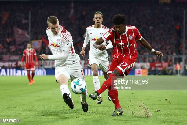 Lukas Klostermann of Leipzig fights for the ball with David Alaba of Bayern Muenchen during the Bundesliga match between FC Bayern Muenchen and RB...