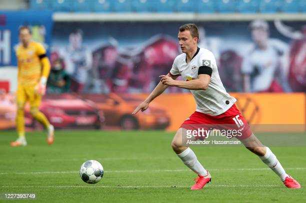Lukas Klostermann of Leipzig runs with the ball during the Bundesliga match between RB Leipzig and Hertha BSC at Red Bull Arena on May 27, 2020 in...
