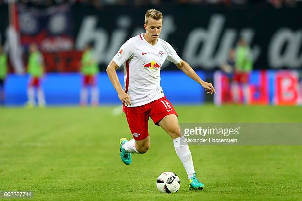 Lukas Klostermann of Leipzig runs with the ball during the Bundesliga match between RB Leipzig and Borussia Dortmund at Red Bull Arena on September...