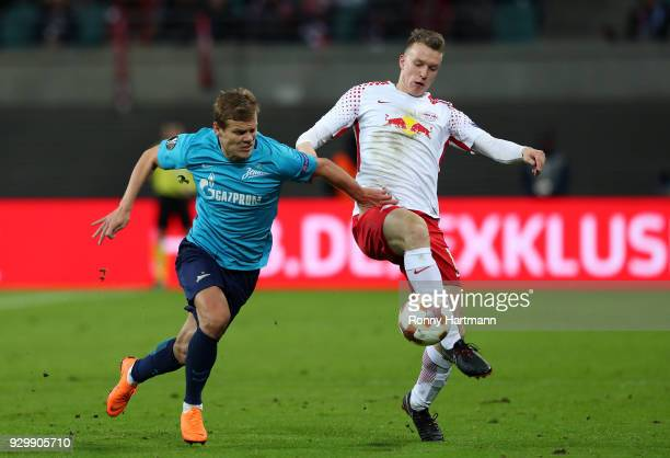 Lukas Klostermann of RB Leipzig and Aleksandr Kokorin of FC Zenit Saint Petersburg compete during the UEFA Europa League Round of 16 match between RB...