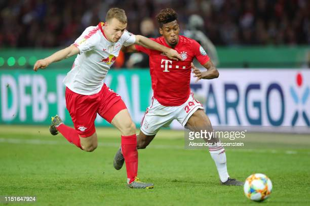 Lukas Klostermann of RB Leipzig battles for possession with Kingsley Coman of Bayern Munich during the DFB Cup final between RB Leipzig and Bayern...