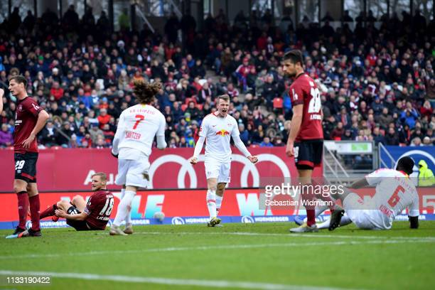 Lukas Klostermann of RB Leipzig celebrates after scoring his team's first goal with his team mates during the Bundesliga match between 1. FC...