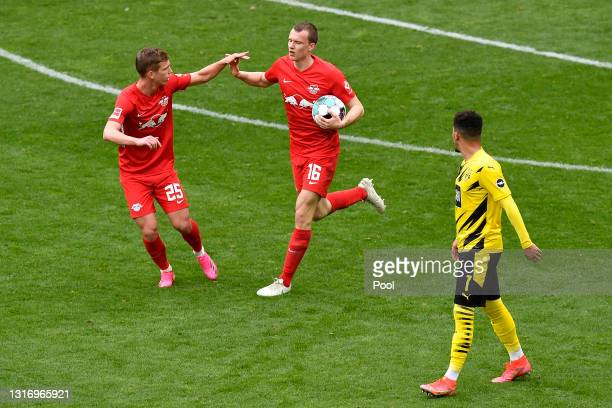 Lukas Klostermann of RB Leipzig celebrates with Dani Olmo after scoring their team's first goal during the Bundesliga match between Borussia Dortmund...