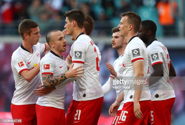 Lukas Klostermann of RB Leipzig celebrates with his team mates after scoring his team's first goal during the Bundesliga match between RB Leipzig and...