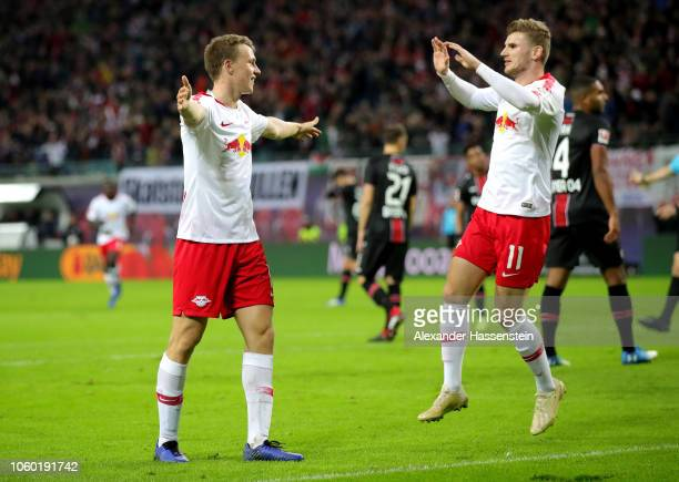 Lukas Klostermann of RB Leipzig celebrates with teammate Timo Werner after scoring his team's second goal during the Bundesliga match between RB...