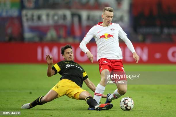 Lukas Klostermann of RB Leipzig is challenged by Thomas Delaney of Borussia Dortmund during the Bundesliga match between RB Leipzig and Borussia...