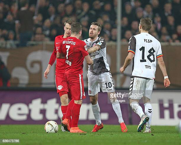 Lukas Klostermann of RB Leipzig Marcel Sabitzer of RB Leipzig Christopher Buchtmann of St Pauli and Lennart Thy of St Pauli discuss during the Second...