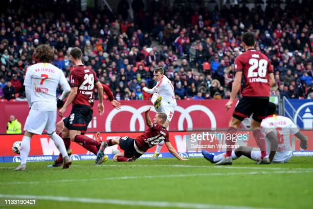 Lukas Klostermann of RB Leipzig scores his team's first goal during the Bundesliga match between 1. FC Nuernberg and RB Leipzig at...