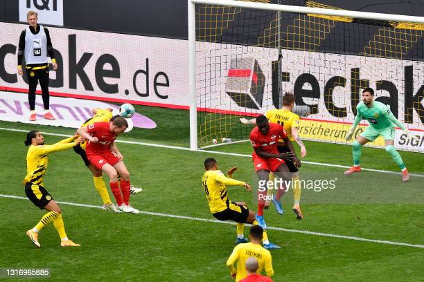 Lukas Klostermann of RB Leipzig scores their team's first goal past Roman Buerki of Borussia Dortmund during the Bundesliga match between Borussia...