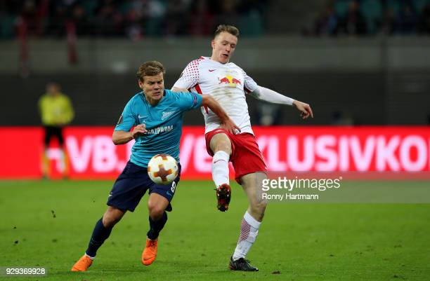 Lukas Klostermann of RB Leipzig vies with Aleksandr Kokorin of FC Zenit Saint Petersburg during the UEFA Europa League Round of 16 match between RB...