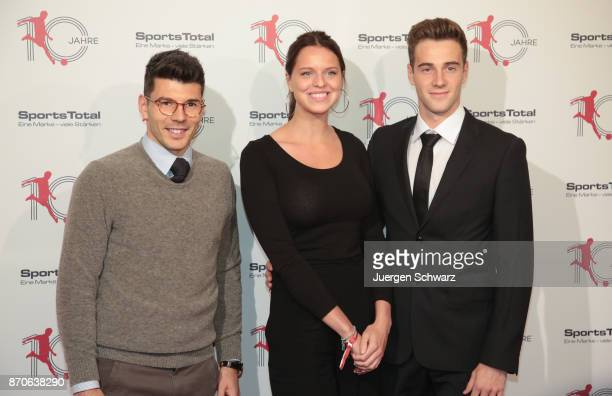 Lukas Kluenter his girlfriend Rebecca and Milos Jojic pose at the 10th anniversary celebration of the Sports Total Agency on November 5 2017 in...