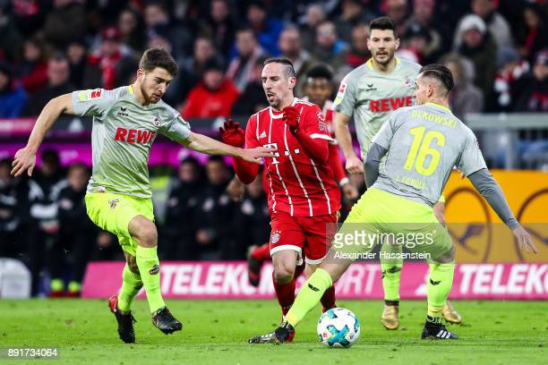 Lukas Kluenter of 1FC Koeln Franck Ribery of Bayern Munich and Pawel Olkowski of 1FC Koeln the Bundesliga match between FC Bayern Muenchen and 1 FC...