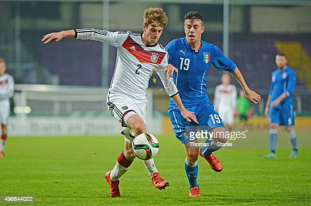 Lukas Kluenter of Germany and Massimiliano Gatto of Italy fight for the ball during the U20 FourNationsTournament match between Germany and Italy at...