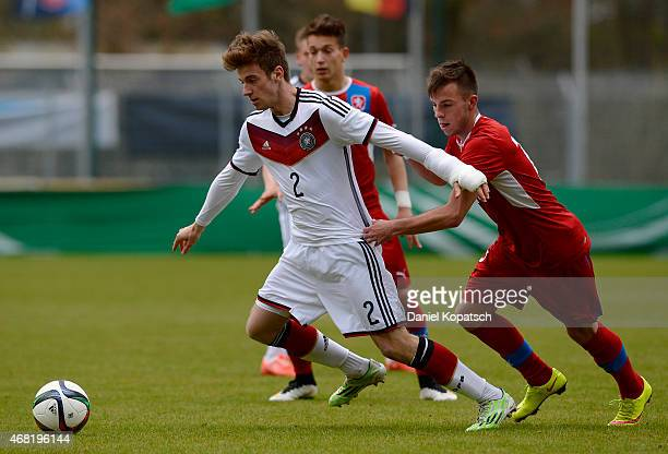 Lukas Kluenter of Germany is challenged by Erik Puchel of Czech Republic during the UEFA Under19 Elite Round match between Germany and Czech Republic...