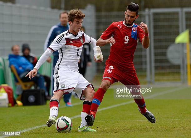 Lukas Kluenter of Germany is challenged by Jakub Yunis of Czech Republic during the UEFA Under19 Elite Round match between Germany and Czech Republic...