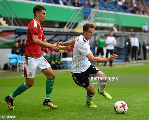 Lukas Kluenter of Germany U21 is challenged by Csaba Spandler of Hungary 21 during the International friendly match between Germany U21 and Hungary...
