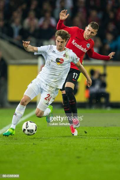 Lukas Kluenter of Koeln and Ante Rebic of Frankfurt in action during the Bundesliga match between 1 FC Koeln and Eintracht Frankfurt at...