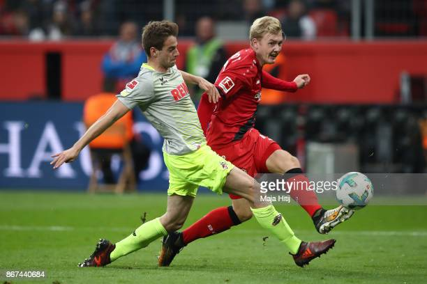 Lukas Kluenter of Koeln and Julian Brandt of Bayer Leverkusen fight for the ball during the Bundesliga match between Bayer 04 Leverkusen and 1 FC...