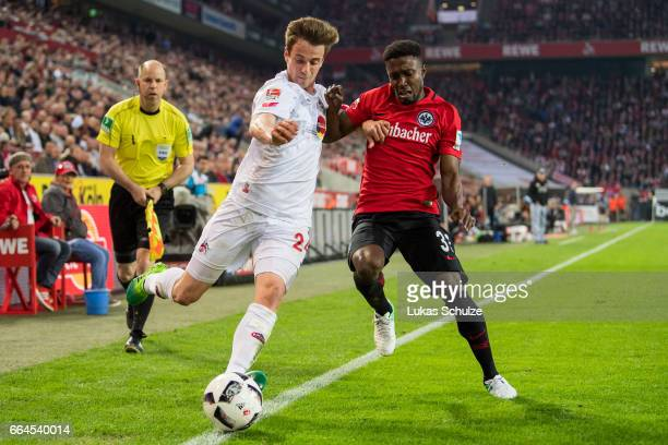Lukas Kluenter of Koeln and Taleb Tawatha of Frankfurt in action during the Bundesliga match between 1 FC Koeln and Eintracht Frankfurt at...