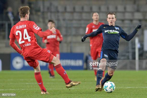 Lukas Kluenter of Koeln and Vladimir Darida of Hertha battle for the ball during the HHotelscom Wintercup match between Hertha BSC and 1 FC Koeln at...