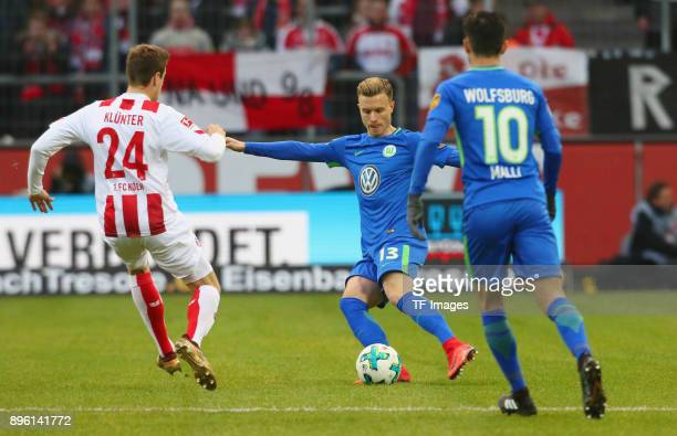 Lukas Kluenter of Koeln and Yannick Gerhardt of Wolfsburg battle for the ball during the Bundesliga match between 1 FC Koeln and VfL Wolfsburg at...