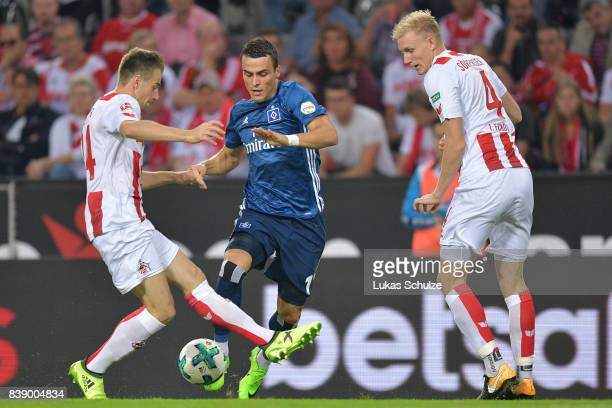 Lukas Kluenter of Koeln Filip Kostic of Hamburg and Frederik Sorensen of Koeln fight for the ball during the Bundesliga match between 1 FC Koeln and...