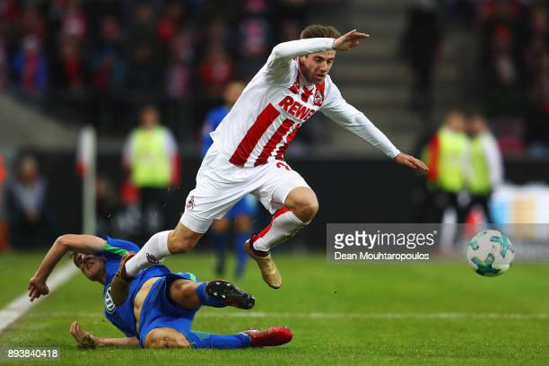 Lukas Klunter of FC Koeln gets past the tackle from Robin Knoche of Wolfsburg during the Bundesliga match between 1 FC Koeln and VfL Wolfsburg at...