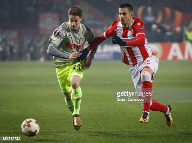 Lukas Klunter of FC Koeln in action against Aleksandar Pesic of Crvena Zvezda during the UEFA Europa League group H match between Crvena Zvezda and 1...
