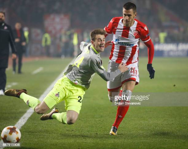 Lukas Klunter of FC Koeln is challenged by Aleksandar Pesic of Crvena Zvezda during the UEFA Europa League group H match between Crvena Zvezda and 1...