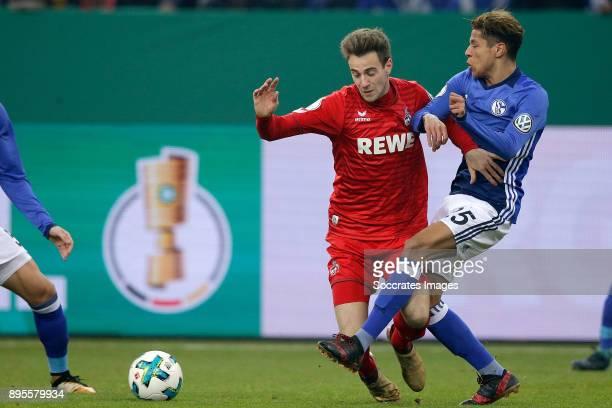 Lukas Klunter of FC Koln Amine Harit of Schalke 04 during the German DFB Pokal match between Schalke 04 v 1 FC Koln at the Veltins Arena on December...
