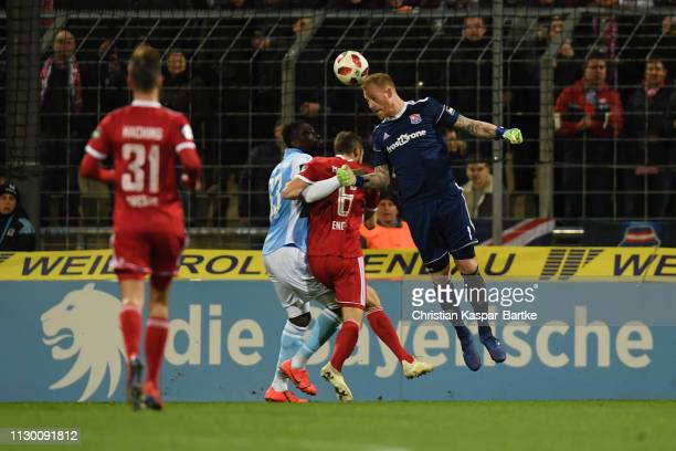 Lukas Koenigshofer of SpVgg Unterhaching challenges Prince Osei Owusu of TSV 1860 Muenchen during the 3 Liga match between TSV 1860 Muenchen and...