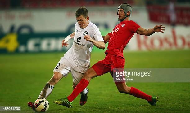 Lukas Kohler of Elversberg is challenged by Klaus Gjasula of Offenbach during the Regionalliga West match between Kickers Offenbach and SV Elversberg...