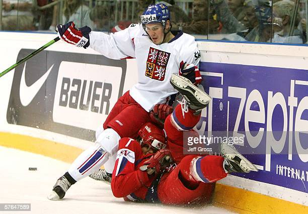 Lukas Krajicek of the Czech Republic collides with Alexei Mikhnov of Russia at the boards during the third period of the IIHF World Championship...