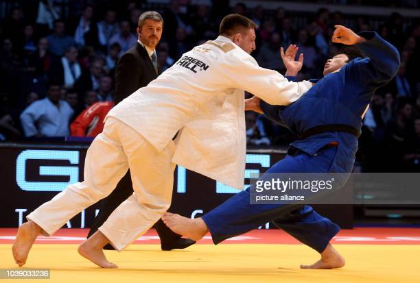 Lukas Krpalek and Kokoro Kageura in action during the men's above 100 kg body weight competition at the Judo Grand Prix in the Mitsubishi Electric...