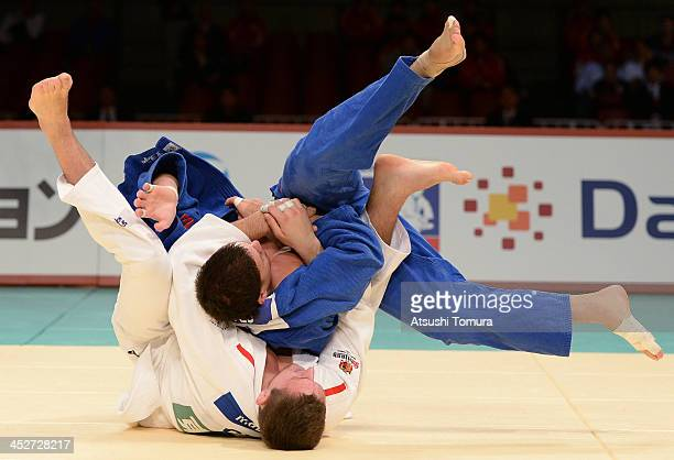 Lukas Krpalek of Czech Republic and Cyrille Maret of Canada compete in the men's 100kg final match during day three of the Judo Grand Slam at the on...