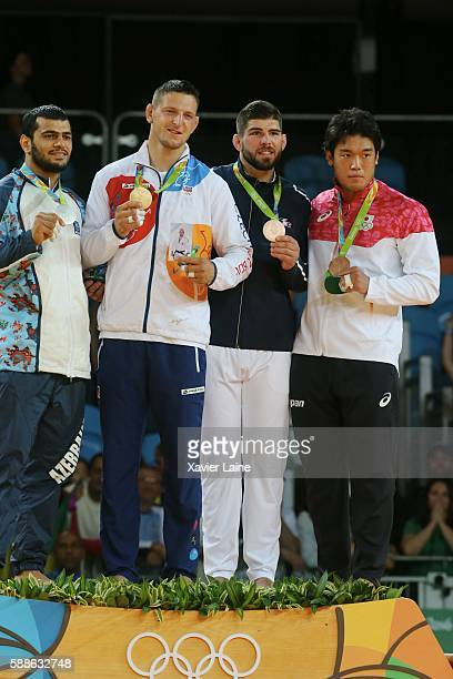 Lukas Krpalek of Czech Republic celebrate his gold medal with Elmar Gasimov of Azerbadjan and Cyrille Maret of France after the final Judo men's...