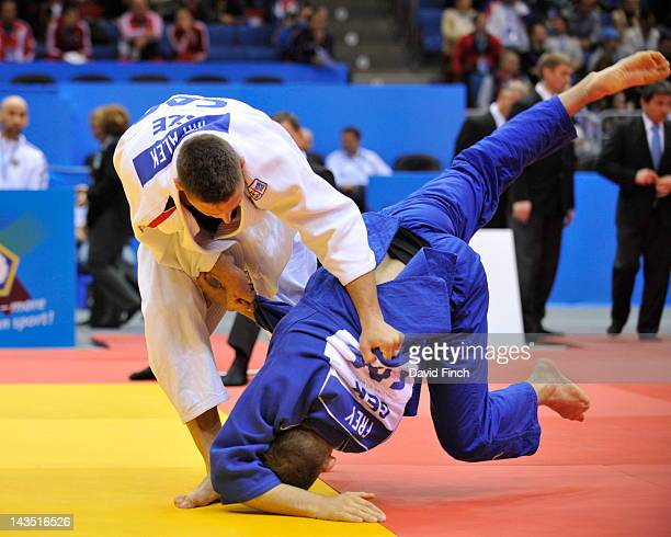 Lukas Krpalek of Czech Republic throws KarlRichard Frey of Germany for ippon in the first round during day 3 eliminations session of the European...