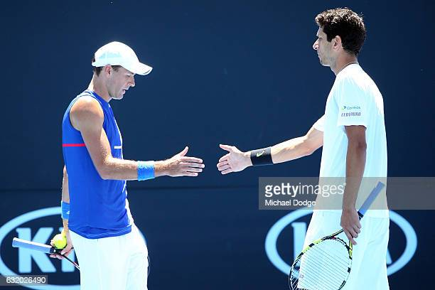 Lukas Kubot of Poland and Marcelo Melo of Brazil high five during theirr first round match against Johan Brunstrom and Andreas Siljestrom of Sweden...