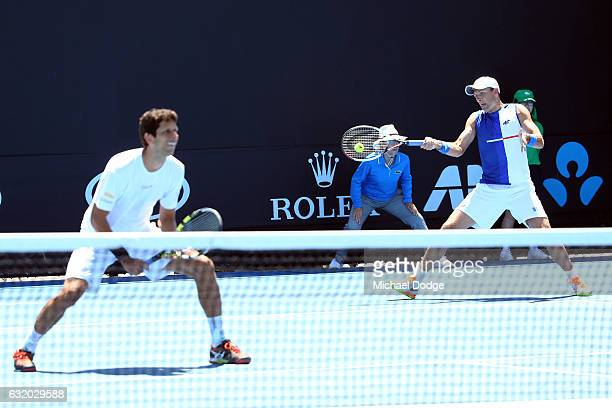 Lukas Kubot of Poland competes with Marcelo Melo of Brazil during their first round match against Andreas Siljestrom of Swedeni and Johan Brunstrom...