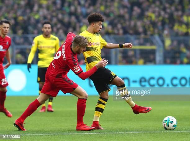 Lukas Kuebler of Freiburg and Jadon Malik Sancho of Dortmund battle for the ball during the Bundesliga match between Borussia Dortmund and SportClub...