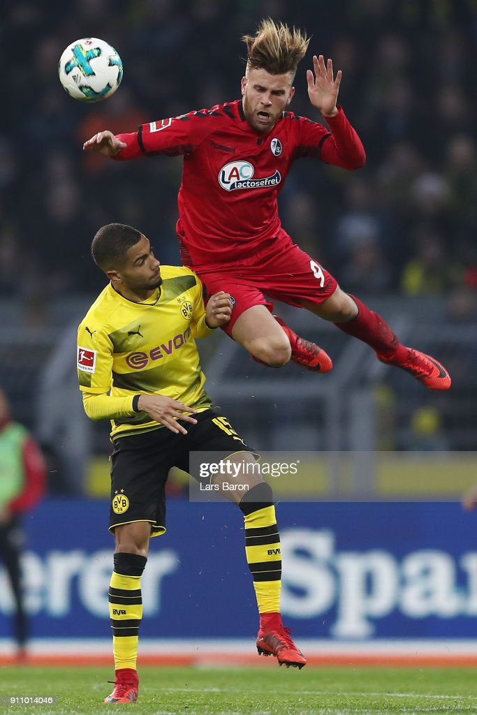 Lukas Kuebler of Freiburg (r) fights for the ball with Jeremy Toljan of Dortmund during the Bundesliga match between Borussia Dortmund and Sport-Club Freiburg at Signal Iduna Park on January 27, 2018 in Dortmund, Germany.