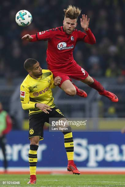 Lukas Kuebler of Freiburg fights for the ball with Jeremy Toljan of Dortmund during the Bundesliga match between Borussia Dortmund and SportClub...