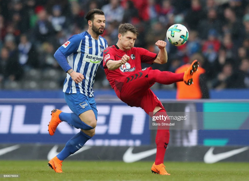 Lukas Kuebler of SC Freiburg is challenged by Marvin Plattenhardt of Hertha BSC during the Bundesliga match between Hertha BSC and Sport-Club Freiburg at Olympiastadion on March 10, 2018 in Berlin, Germany.