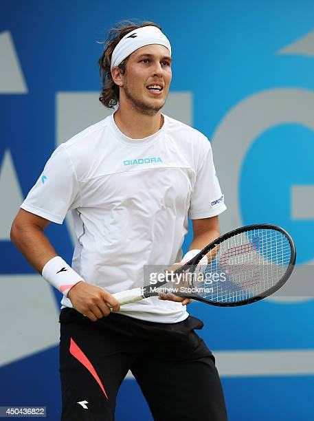 Lukas Lacko of Slovakia in action against Marinko Matosevic of Australia during their Men's Singles match on day three of the Aegon Championships at...